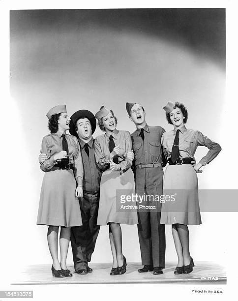 The Andrews Sisters sing with Lou Costello and Bud Abbott in a promotional portrait for the film 'Buck Privates' 1941