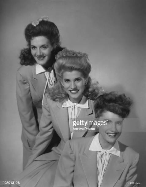 The Andrews Sisters LaVerne Sophia Andrews Patricia Marie Andrews and Maxene Angelyn Andrews smiling and wearing matching outfits USA circa 1940