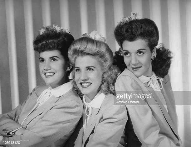 The Andrews Sisters Maxene Angelyn Andrews Patricia Marie Andrews and LaVerne Sophia Andrews smiling while looking to the left of the image USA circa...