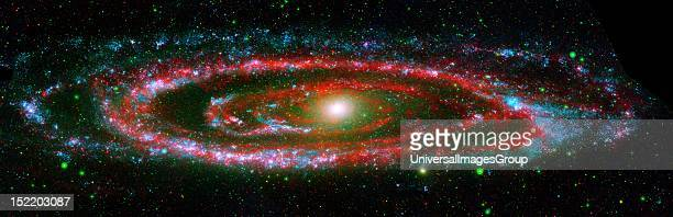 the Andromeda galaxy in a composite image from NASA's Galaxy Evolution Explorer and the Spitzer Space Telescope Spitzer's supersensitive infrared...