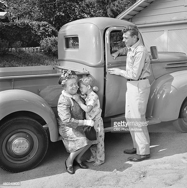 The Andy Griffith Show episode The New Housekeeper This is from season 1 episode 1 From left Frances Bavier holding Ron Howard and Andy Griffith...