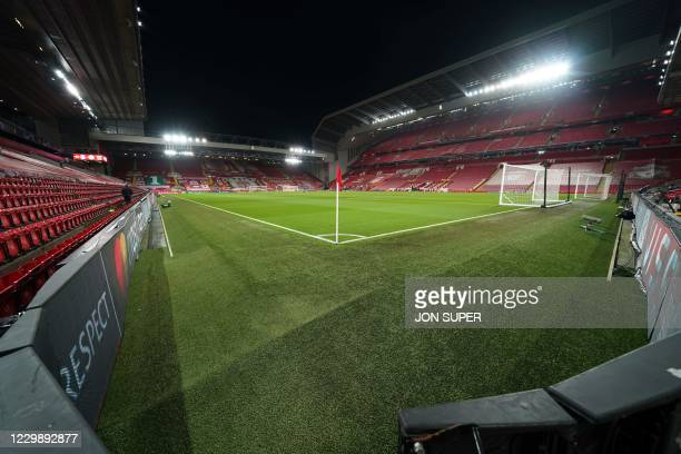 The Anfield pitch under the floodlights waits for players to warm up ahead of the Champions League 1st round Group D football match between Liverpool...