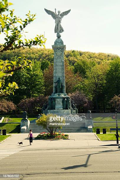 the angel of mont-royal on park avenue, montreal, summer. - montréal stock pictures, royalty-free photos & images