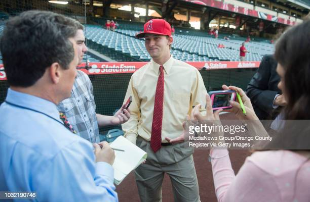 The Angels' firstround draft pick Taylor Ward talks with reporters before the Halos' 54 victory over the Oakland Athletics Friday night at Angel...
