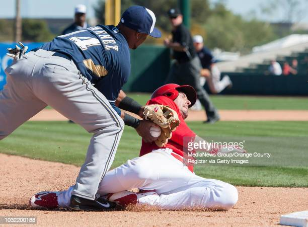 The Angels' Matt Joyce is tagged out at third by the Brewers' Luis Jimenez during the Halos' Spring Training home opener at Tempe Diablo Stadium...