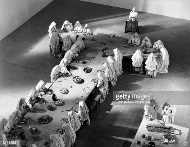 The Anglican nuns sit down to a meal in their Himalayan community in a scene from 'Black Narcissus' directed by Michael Powell and Emeric Pressburger