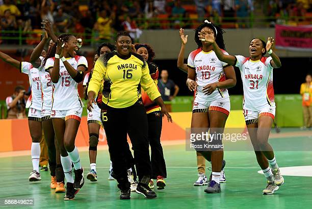 The Angolan team celebrate after the Women's Handball match between Romania and Angola on Day 1 of the Rio 2016 Olympic Games at Future Arena on...