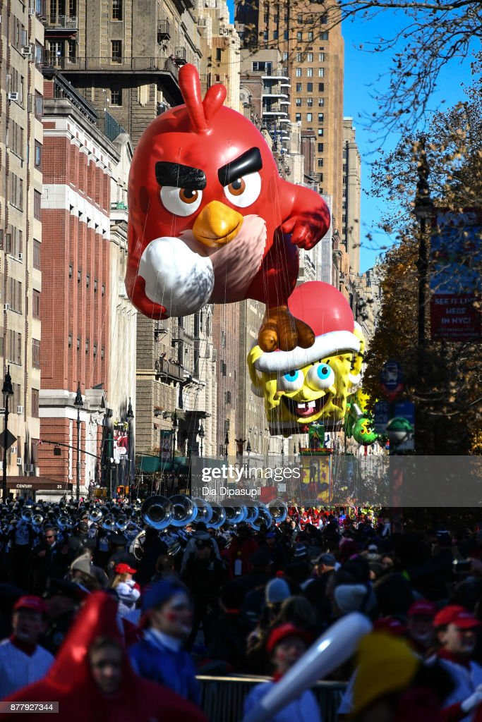 The Angry Birds and SpongeBob SquarePants balloons float down Central Park West during the 91st Annual Macy's Thanksgiving Day Parade on November 23, 2017 in New York City.
