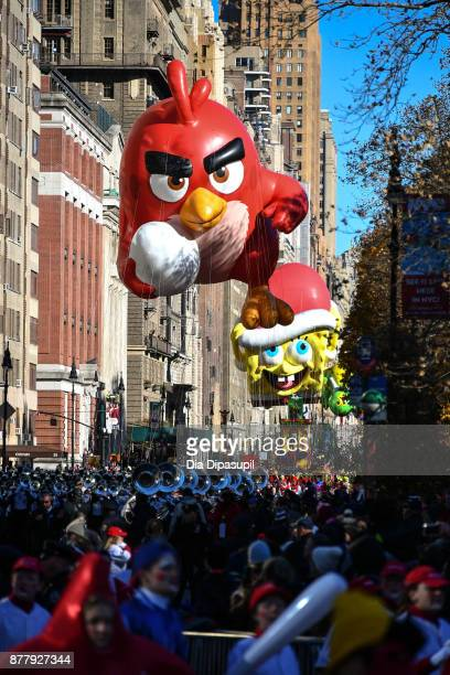 The Angry Birds and SpongeBob SquarePants balloons float down Central Park West during the 91st Annual Macy's Thanksgiving Day Parade on November 23...
