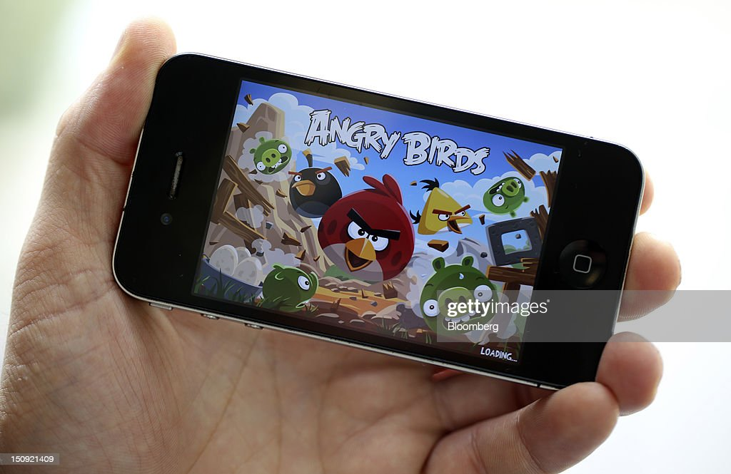 The ''Angry Birds'' mobile-phone game, designed by Rovio Mobile Oy is seen on an Apple Inc. iPhone 4 smartphone in this arranged photograph in London, U.K., on Wednesday, Aug. 29, 2012. Apple Inc. is seeking a U.S. sales ban on eight models of Samsung Electronics Co. smartphones and the extension of a preliminary ban on a tablet computer after winning a patent trial against the South Korean company. Photographer: Chris Ratcliffe/Bloomberg via Getty Images