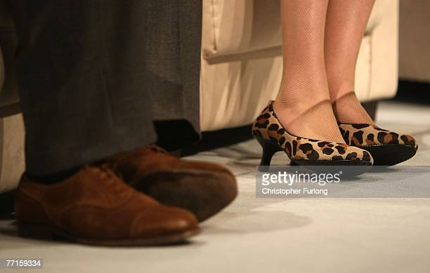 The animal print shoes of Shadow Leader of the House of Commons Theresa May contrast to the suede shoes of Ken Clarke during a question and answer...