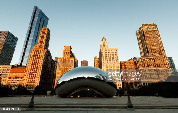 The Anish Kapoor designed sculpture Cloud Gate at sunrise Nicknamed The Bean in Millennium Park Chicago Buildings and Landmarks Chicago