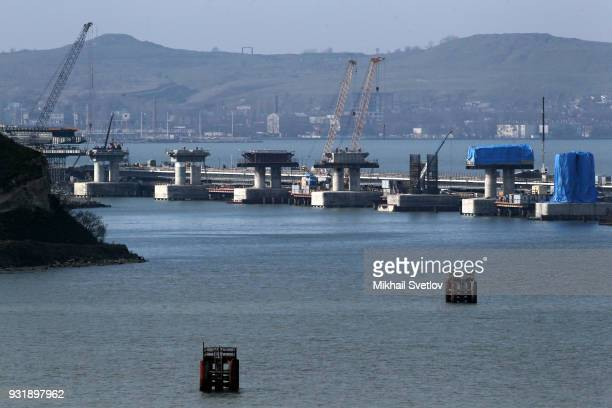 The annexed Ukrainian territory of Crimea can be seen behind the Crimean bridge which is being built to connect the Krasnodar region of Russia and...