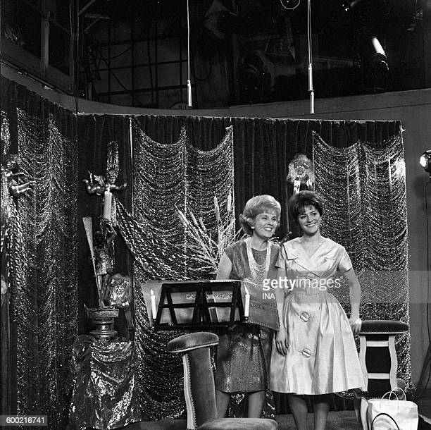 The announcers Catherine Langeais and Anne Marie Peysson on the set of a program during the Christmas time