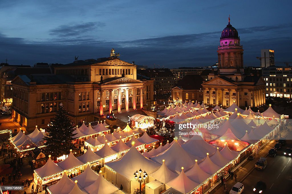 The annual Christmas market at Gendarmenmarkt stands illuminated in the city center on its opening day on November 26, 2012 in Berlin, Germany. Christmas markets, with their stalls selling mulled wine, Christmas tree decorations and other delights, are an integral part of German Christmas tradition, and many of them opened across Germany today.