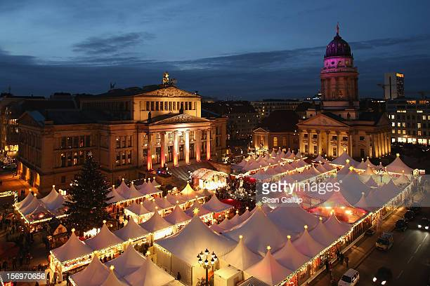 The annual Christmas market at Gendarmenmarkt stands illuminated in the city center on its opening day on November 26 2012 in Berlin Germany...