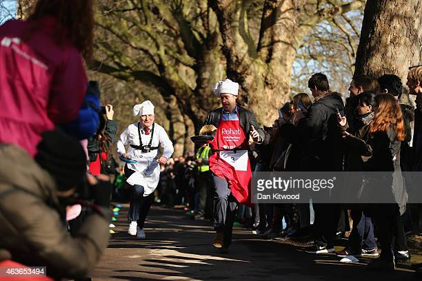 The annual Parliamentary Pancake Race takes place in Victoria Tower Gardens on Shrove Tuesday on February 17 2015 in London England Now in its 19th...