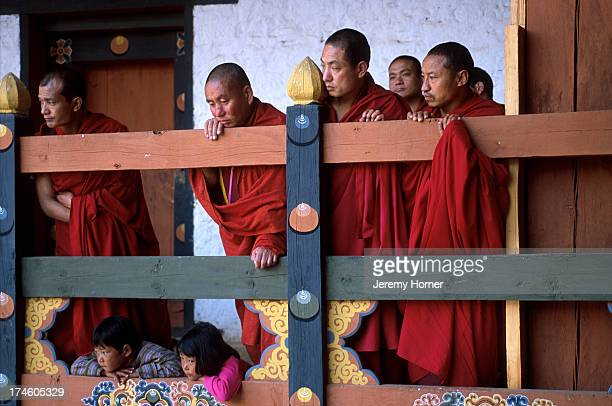 The annual Punakha Festival draws hilltribespeople down from the higher valleys to mingle with hundreds of buddhist monks at Punakha Dzong..