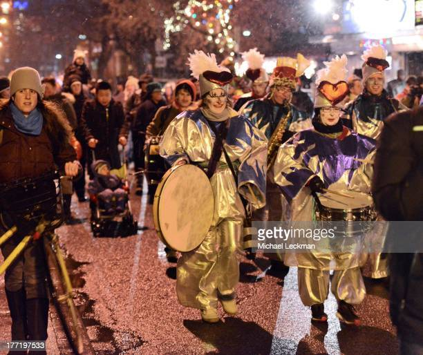 CONTENT] The annual solstice parade in Kensington Market Toronto braved chilly winds with handmade lanterns choral singers musicians drummers ISO...