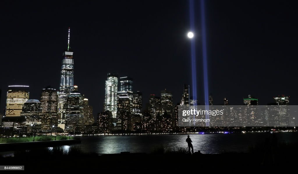 The annual Tribute in Light is tested in lower Manhattan in New York City as the moon rises on September 7, 2017 as seen from Jersey City, New Jersey.