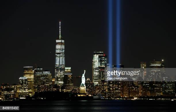 The annual Tribute in Light is tested in lower Manhattan in New York City on September 10 2017 as seen from Bayonne New Jersey