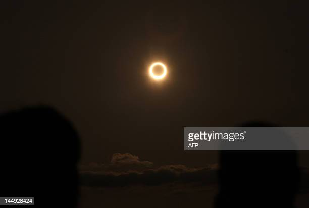 The annular solar eclipse is seen from the coast of Xiamen in China's southeast province of Fujian on May 21 2012 Millions turned their eyes to the...