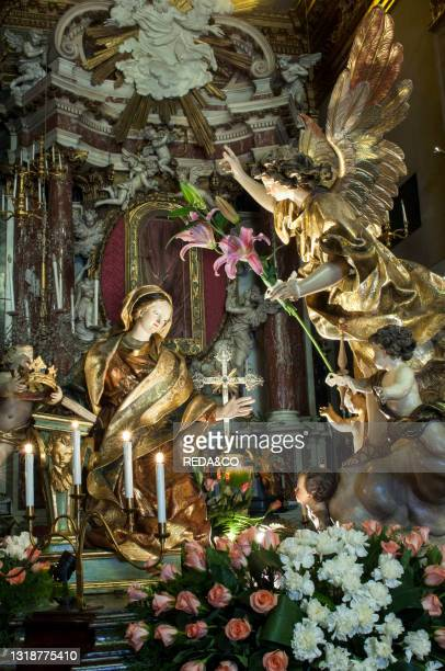 The Annunciation by Anton Maria Maragliano Confraternity of the Risen ChristThe Good Friday Procession in Savona is a religious event. Which dates...