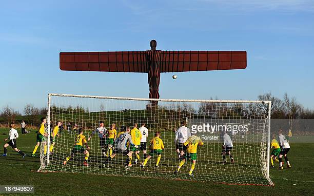 The Anthony Gormley Angel of the North sculpture overlooks the match between Gateshead and Esh Winning on May 2 2013 in Gateshead England
