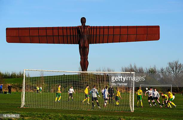 """The Anthony Gormley """"Angel of the North"""" sculpture overlooks the match between Gateshead and Esh Winning on May 2, 2013 in Gateshead, England."""
