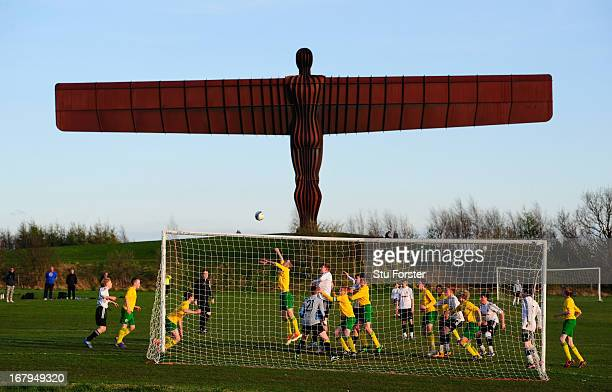 """The Anthony Gormley's """"Angel of the North"""" sculpture overlooks the match between Gateshead and Esh Winning on May 2, 2013 in Gateshead, England."""