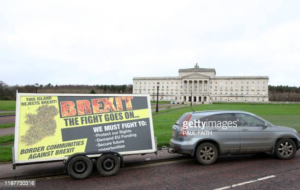 The antiBrexit organisation Border Communities Against Brexit drive a new billboard past the Parliament Buildings on the Stormont Estate in Belfast...