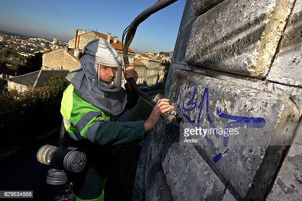 The antigraffiti squad was created in Angouleme to clean the walls systematically covered with graffitis Municipal officer cleaning the walls of the...
