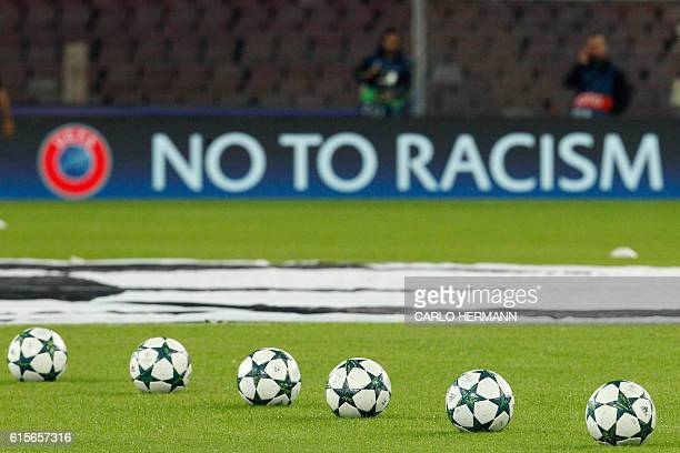 The antiracism slogan 'No to Racism' is displayed on a board along the pitch prior the UEFA Champions League football match SSC Napoli vs Besiktas on...