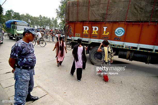 The Anu Kardhaka a 17 year old from Dadhing district North of Katmandu is taken away from the truck driver into safety by Maiti workers October 21...