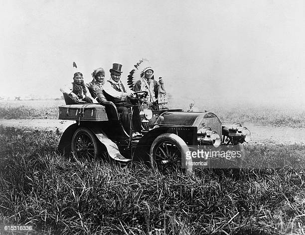 The Apache leader Geronimo drives a Ford automobile ca 1904 carrying three other Native American passengers
