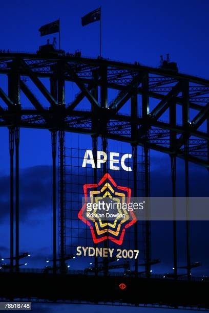 The APEC Australia 2007 logo is illuminated on the Sydney Harbour Bridge to welcome the AsiaPacific Economic Cooperation meetings to Sydney on day...