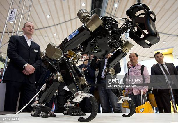 The apelike robotic system Charlie walks on all of his four limbs during a demonstration at the 2014 CeBIT computer technology trade fair on March 10...