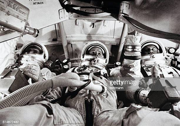 The Apollo 1 astronauts Chaffee White and Grissom prepare for their mission in a flight simulator Eight days later they would be killed in a training...