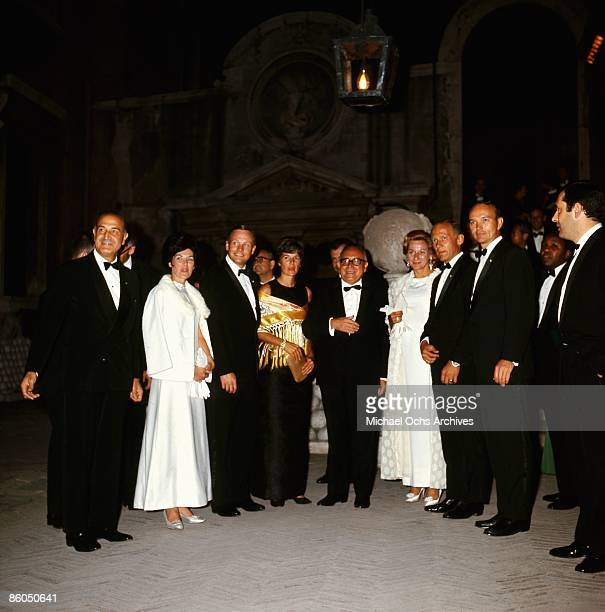 The Apollo 11 astronauts and their wives pose for a portrait at a reception with the President of the Council of Ministers Mariano Rumor at the...