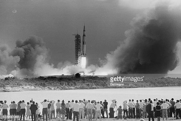 The Apollo 11 mission gets underway at 932 AM EDT as the Saturn V rocket carrying the spacecraft on its nose blasts off Photo shows a small part of...