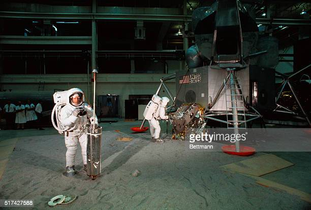 The Apollo 11 moon explorers run through their first full dress rehearsal here on activities they must perform on the lunar surface in July In the...