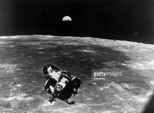 The Apollo 11 space module floating above the Moon The Earth can be seen rising behind