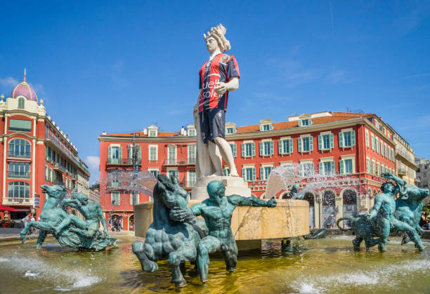 the Apollo statue in the Fontaine du Soleil on Place Masséna, Nice,  Côte d'Azur, wears the colours of the OGC Nice soccer team