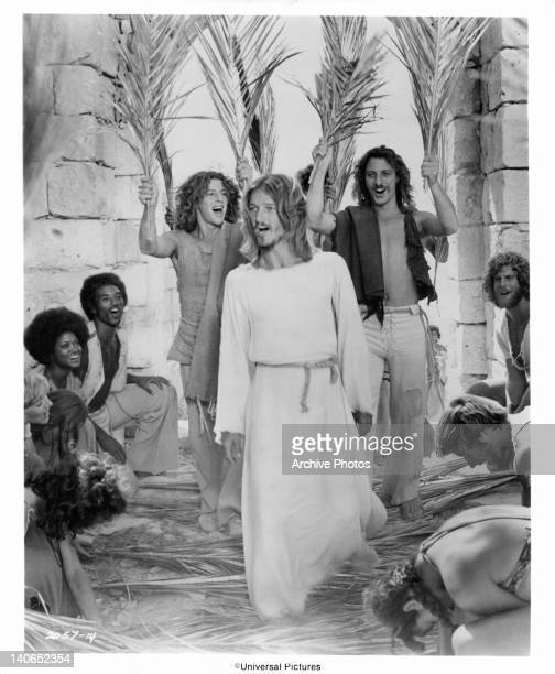 The Apostles and their women lay down palm fronds as Ted Neeley enters Jerusalem followed by Richard Orbach and Robert Lupone in a scene from the...