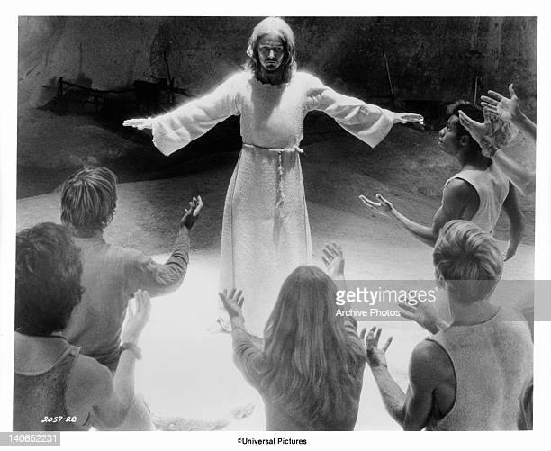 The Apostles raise their arms to Ted Neeley after he has accused them of not caring if he comes or goes in a scene from the film 'Jesus Christ...