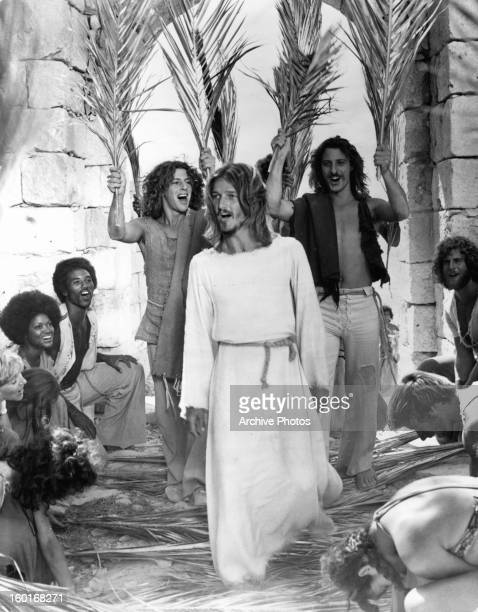 The apostles raise their arms to Ted Neeley in a scene from the film 'Jesus Christ Superstar', 1973.