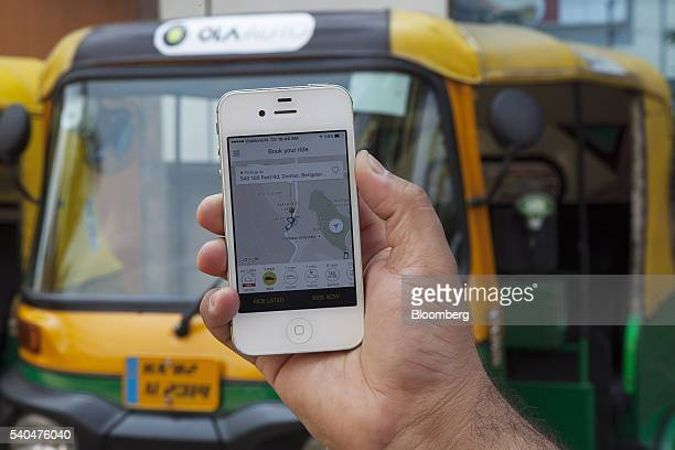 The app of ridehailing service Ola owned by ANI Technologies Pvt is displayed in Bengaluru India on Saturday May 7 2016 Bhavish Aggarwal cofounder of...