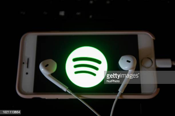 The app of the music streaming app Spotify is seen on a screen while some headphones are lying on it The numbers of people using music streaming apps...