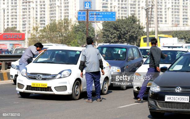 The appbased cab operators forced to observe the strike at Subash Chowk Sohna Road on February 11 2017 in Gurgaon India The drivers are demanding...
