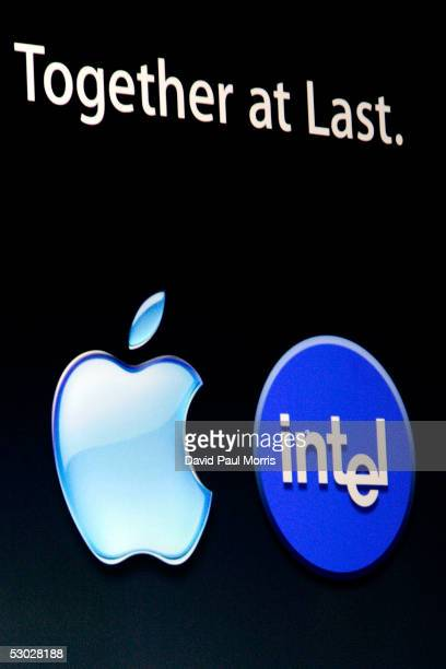 The Apple and Intel logos appear on a screen during the keynote speech at the Apple Worldwide Developers conference with his keynote speech June 6...